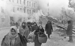 Leningradians leaving their houses destroyed by Nazi bombings.