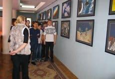 В музее Байконура проходит благотворительная фотовыставка космонавта Юрия Лончакова